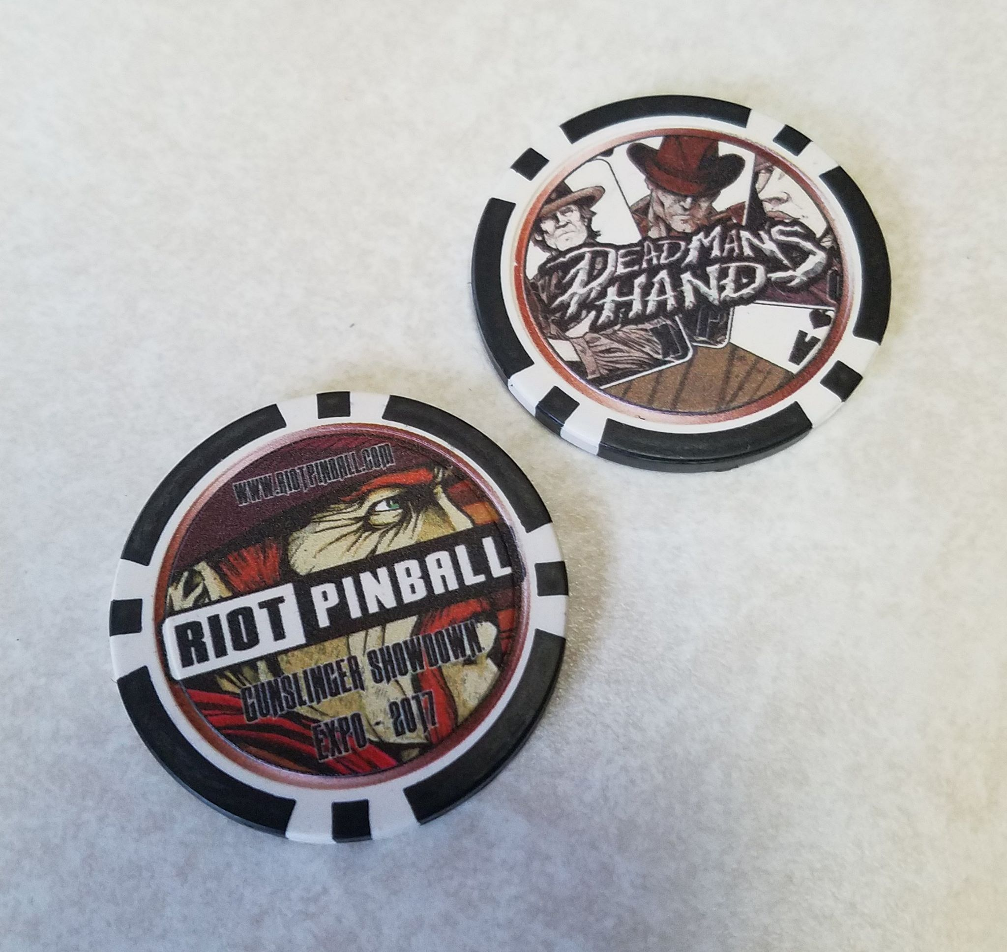 fdcf05150b185 ... what appear to be casino chips (or coasters) with the same images on  them (click images to enlarge). Could this hint a western casino-themed  game