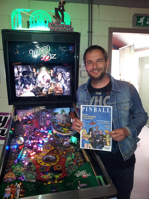 Wizard of Oz graphics animator Jean-Paul de Win posing next to the game he worked on, holding a testprint of PM02. JP also did the finishing touches on the cover.