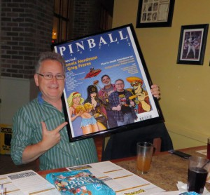 Greg Freres with his framed Pinball Magazine cover poster