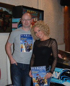 Jonathan Joosten and Melanie Morren next to the Party Animal pinball machine in the Pinball Magazine stand at Dutch Pinball open 2013.