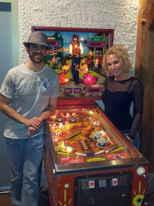 Zach Sharpe and Melanie Morren next to Sharpeshooter, a game designed by Zach's father Roger Sharpe. Zach would eventually win the main tournament the next day.