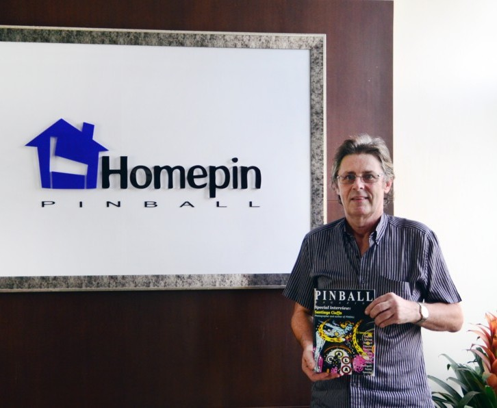 Mike Kalinowski of Homepin Pinball with the supplement magazine at his factory in China