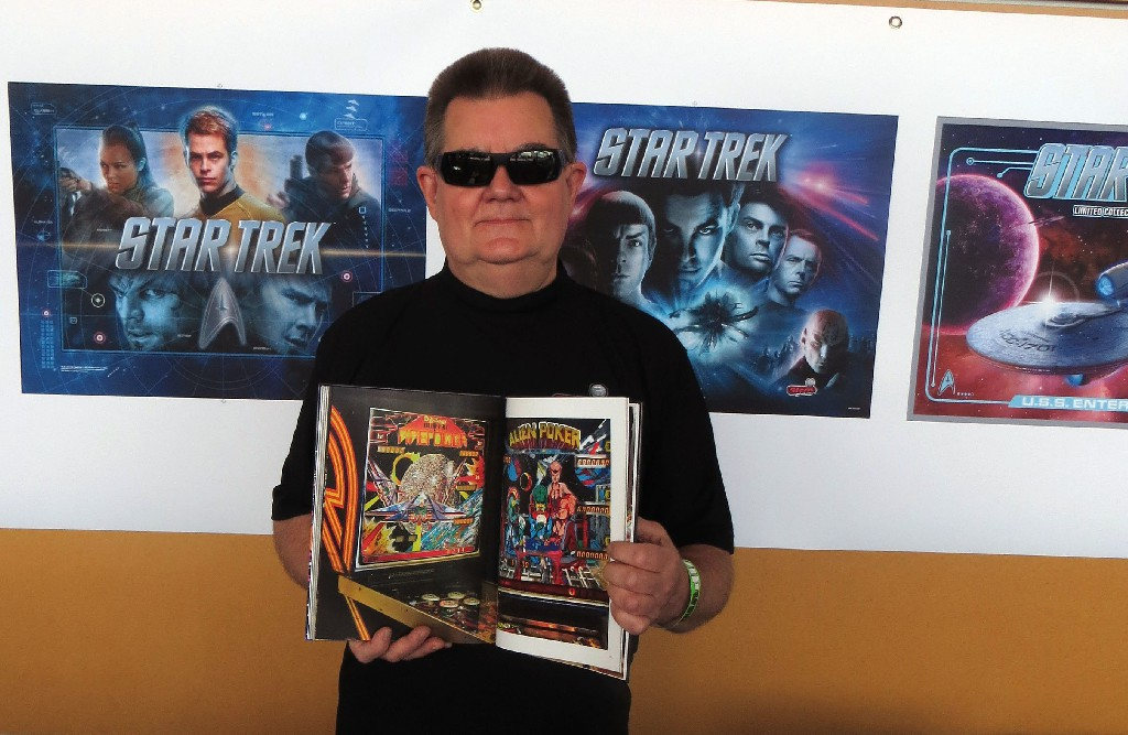 Pinball designer Steve Ritchie with his copy of PINBALL, showing the Firepower page.