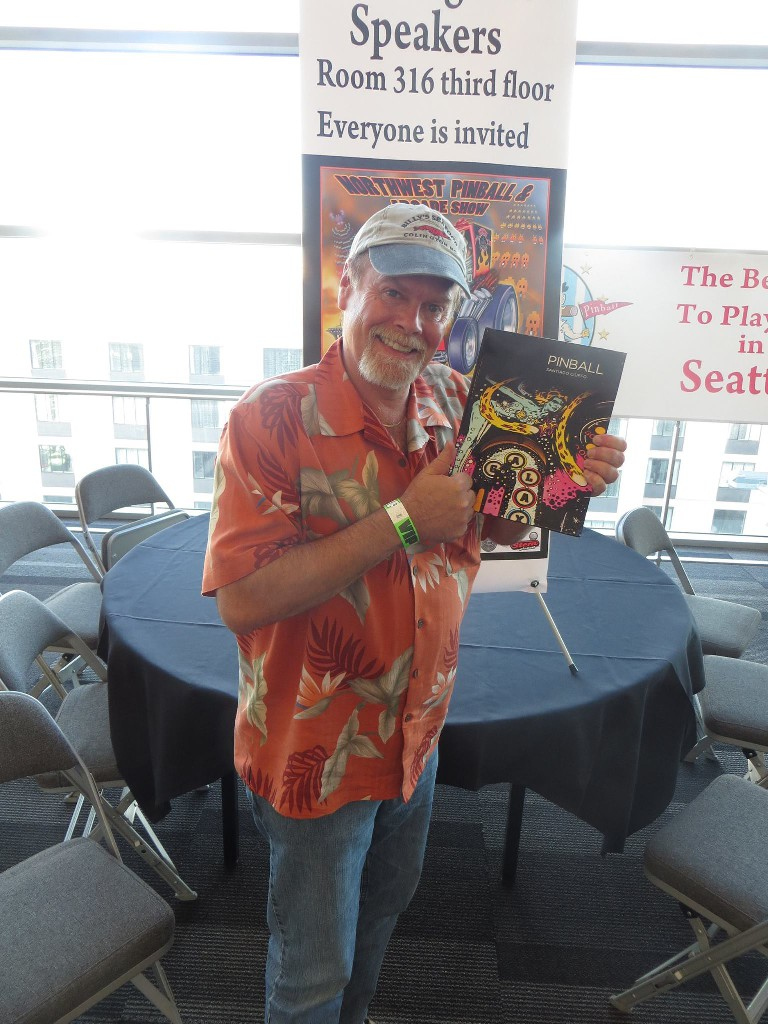 Pinball artist Pat McMahon is happy with his copy of PINBALL.