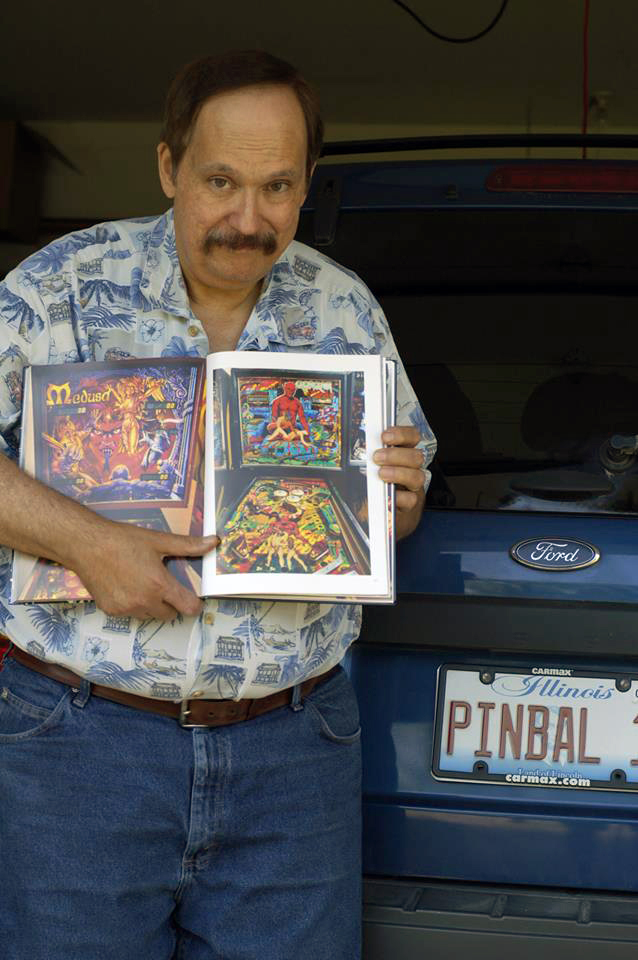 Pinball designer Barry Oursler showing his 'Gorgar' game in Santiago Ciuffo's PINBALL book