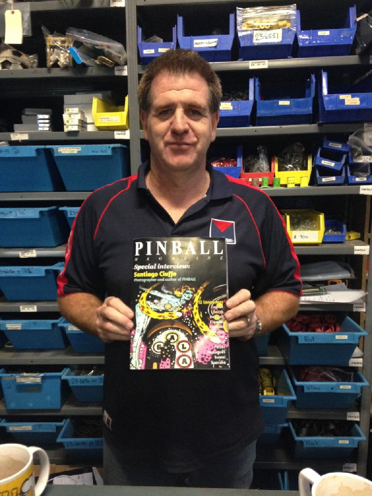 Mark Culbert (Pinball Spare Parts Australia) with the supplement magazine that comes with Santiago Ciuffo's PINBALL book