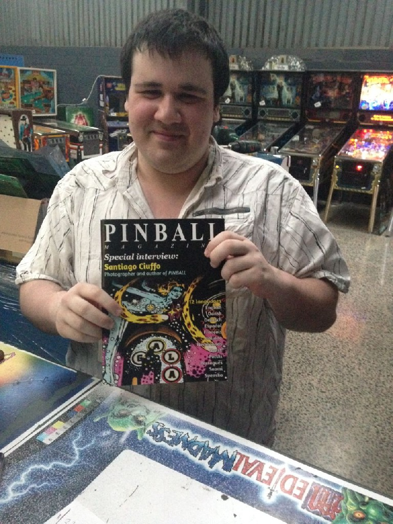 Nathan Culbert posing with the Pinball book supplement magazine